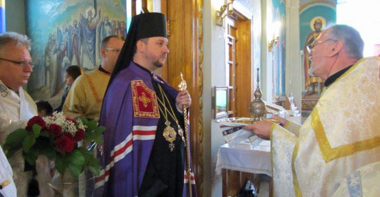 Image of Bishop Andrij being greeted by parish priest.